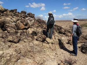 Troy Rasbury and Elena Steponaitis approaching a mound of carbonate